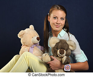 Young woman with teddy bears