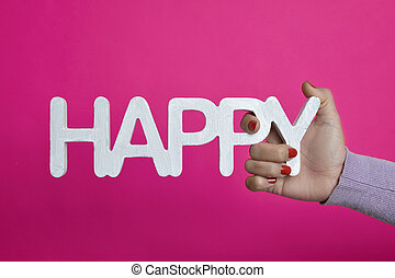 young woman with the word happy in her hand