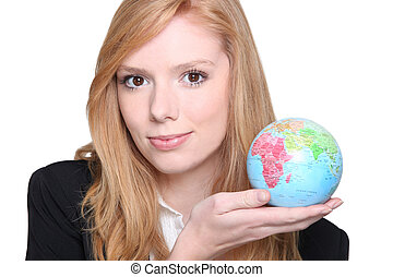Young woman with the world in the palm of her hand