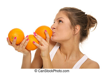 Young woman with three oranges