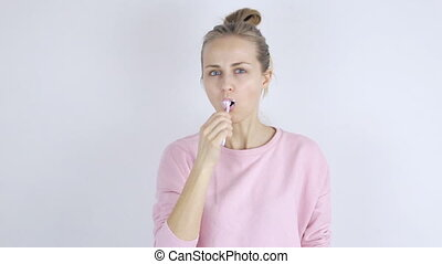 Young woman with toothbrush. Woman brushing teeth