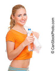 Young woman with towel and water bottle