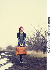 Young woman with travel bag