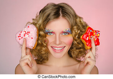 young woman with two donuts