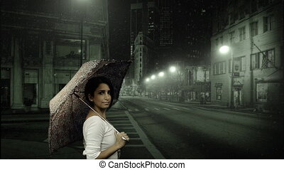 Young woman with umbrella in snow
