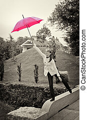 Young woman with umbrella in the park. Black and white
