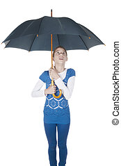 Young woman with umbrella looking up