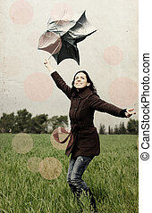 Young woman with umbrella. Photo in old color image style.
