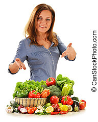 Young woman with variety of vegetables isolated on white