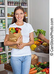 Young Woman With Vegetable Bag