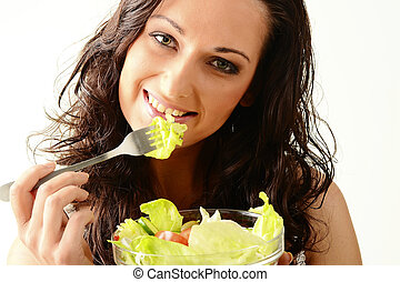 Young woman with vegetable salad bowl