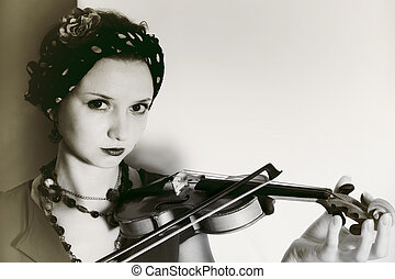 Young woman with violin on light background