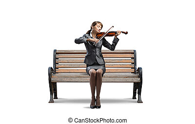 Young woman with violin on wooden bench