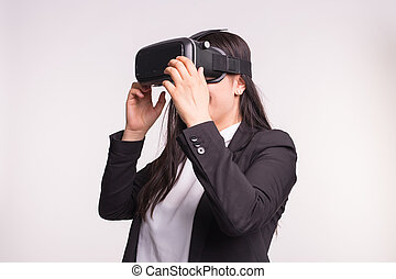 Young woman with virtual reality helmet on white background