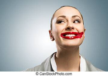 young woman with vivid red mouth