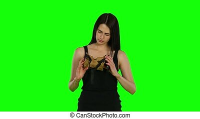 Young woman with VR virtual reality headset on her head, green screen