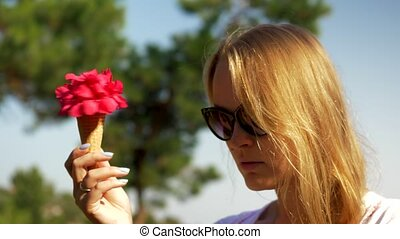 Young woman with waffle cone bouquet outdoor - Close-up loop...