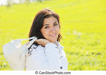 Young woman with white bag