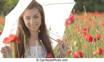 Young woman with white umbrella sit