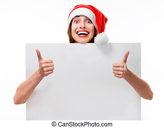 Young woman with whiteboard on Christmas
