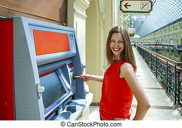 6178836530c6 Young woman withdrawing money from credit card at ATM. Young happy brunette  woman withdrawing money ...