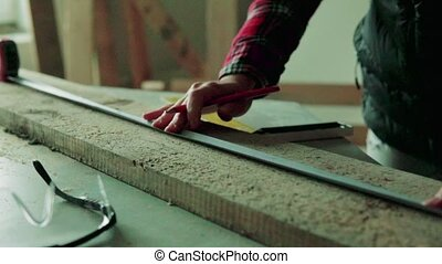 Young woman worker in the carpenter workroom. - Young woman...