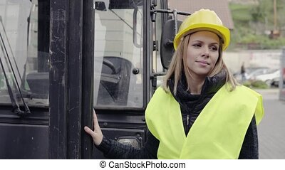 Young woman worker in the industrial area.