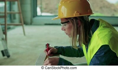 Young woman worker on the building site. - Female worker on...