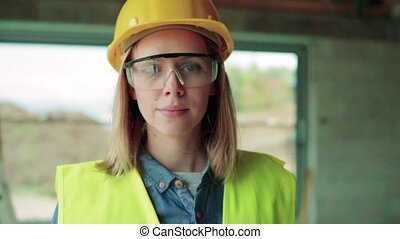 Young woman worker on the construction site. - Female worker...