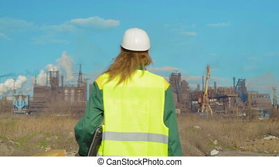 Young woman worker on the construction site