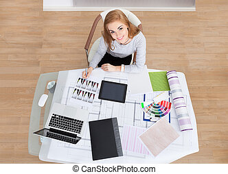 Young Woman Working At Office Desk