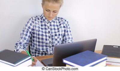 Young woman working behind laptop