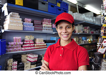 young woman working in a gift box store - portrait of a...