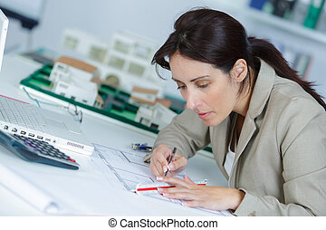 young woman working in office sitting at desk
