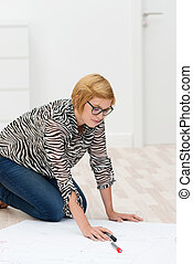 Young woman working on a floor plan