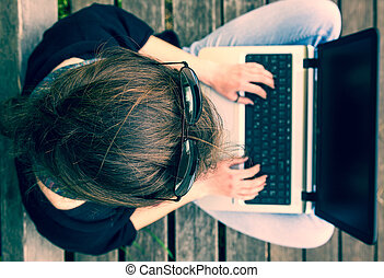 Young woman working on a laptop. View from above.