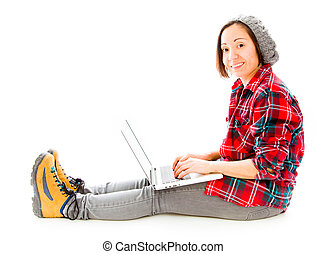 Young woman working on a laptop with smiling - young adult...