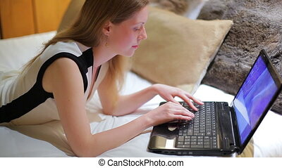 Young woman working on laptop.