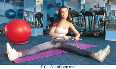 Young Woman Working Out At The Gym