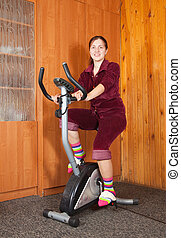 woman working out on exercycle