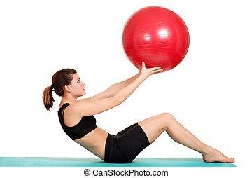 young woman working out with ball