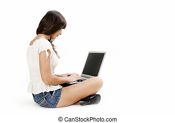 Young woman working with laptop on white background