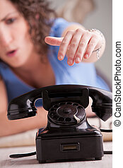 young woman worried by a telephone call
