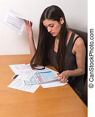 young woman worried over bills