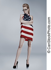 Young woman wrapped in american flag