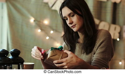 Young Woman Wrapping Christmas Gifts At Home