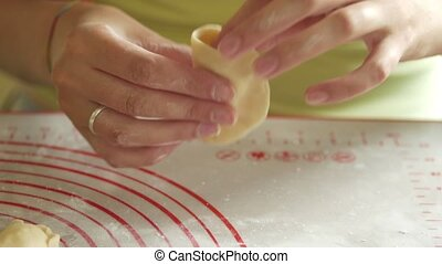 young woman wrapping up cottage cheese in dough making dumpling 4K close-up
