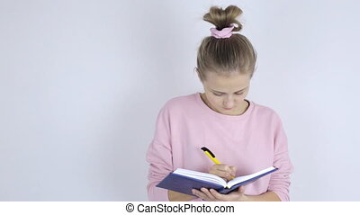 Young woman writes in her notepad - Beautiful young woman...