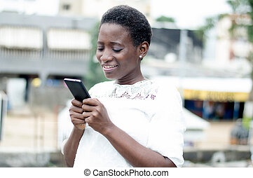 young woman writes messages on his mobile phone.