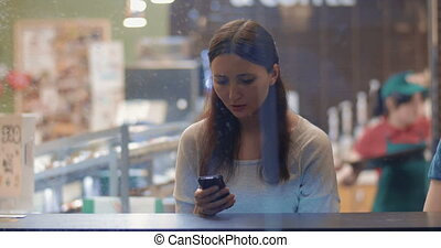 Young Woman Writing Messages in Smartphone